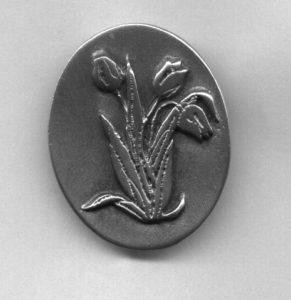 Pewter pin of tulips
